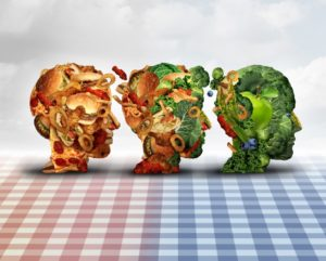 Changing diet healthy lifestyle achievement concept dieting progress change as a healthy lifestyle improvement symbol and evolving from unhealthy junk food to fresh fruits and vegetables shaped as a human head.
